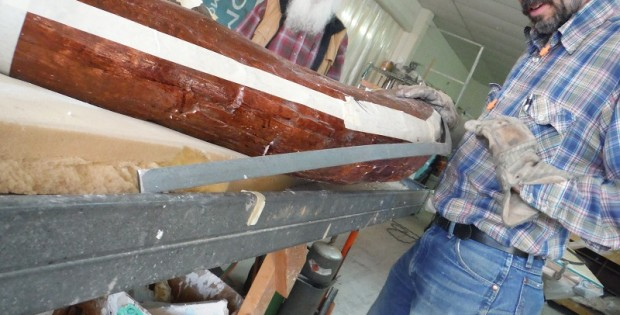James Taylor bends the metal to fit the taped line that will support the real tusks